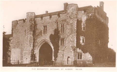 "Title: Old Monastery Gateway, St Albans - Publisher: ""The Kingsbury Series""  No 15A [Identical picture, title and reference number published by Lilywhite]"